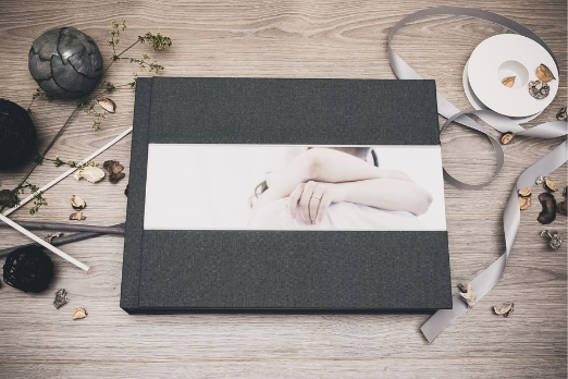 Photo showing one of my wedding album. Fabric cover, with photo printed on it. Italian handmade product