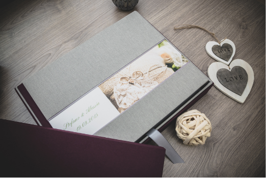 A photo showing one of my wedding album. Fabric cover, with photo printed on it and description of the date and names. Italian Handmade Product