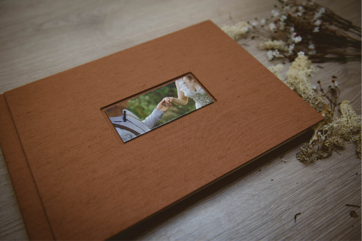 A picture showing one of my wedding album. Fabric cover, with printed photo on it. Handmade Italian product