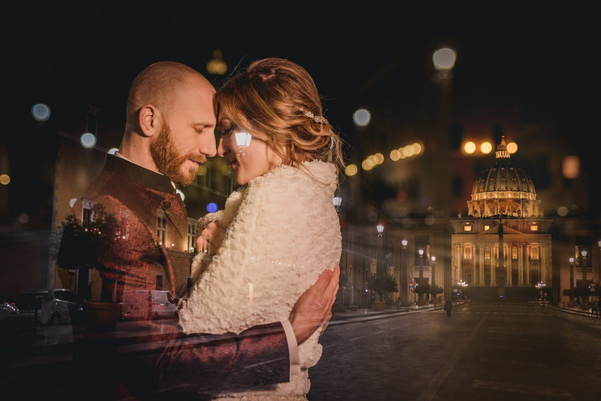 Couple eloping in Italy. Portrait of the couple hugging in front of S. Peter Church in Rome