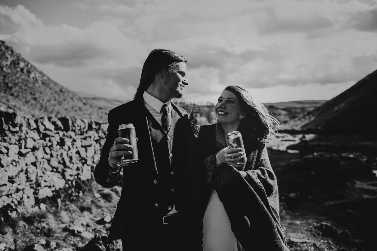 Just married couple walking together and celebrating drinking their favourite drink: beer!